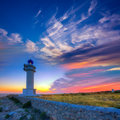 Barbaria berberia cape lighthouse formentera sunset at in balearic islands Stock Photo