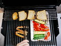 Barbecue bbq on a grill at a nice evening Royalty Free Stock Photo