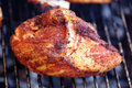 Barbecue chicken breast on grill closeup cooking Royalty Free Stock Photo