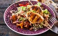 Barbecue chicken skewer dish with quinoa close up Royalty Free Stock Photo