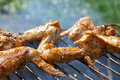 Barbecue chicken wings grilled at summer weekend Stock Photo