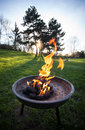Barbecue fire with burning coals in a pit Royalty Free Stock Photo