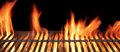 Barbecue fire grill close up on black background Stock Images