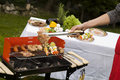 Barbecue in the garden, cook hand Royalty Free Stock Photos
