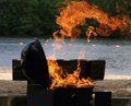 Barbecue grill fire shoots from lakeside Royalty Free Stock Photo
