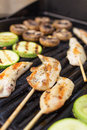 Barbecue grill marinated chicken fillets with vegetables on Royalty Free Stock Photos