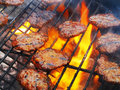 Barbecue grill steaks on a with orange flames Stock Images