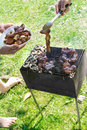 Barbecue grilled meat outdoor food hand cooking mushrooms Royalty Free Stock Photos