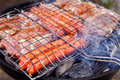 Barbecue with  meat sausages and pork steak Stock Images