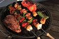 Barbecue shish kabob and steak Stock Images