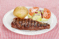 Barbecue steak with salad and baked potato Stock Image