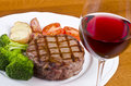 Barbecued Beef Steak and a Glass of Red Wine #4 Royalty Free Stock Photography