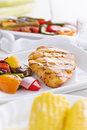 Barbecued chicken with fresh vegetables Royalty Free Stock Photo