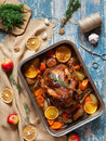 Barbecued chicken with various vegetables and garlic in baking dish. Royalty Free Stock Photo