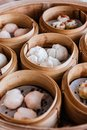 Barbecued pork buns served in steamer baskets with many kind of Dim sum Royalty Free Stock Photo