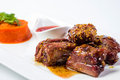Barbecued pork ribs served with tomato sauce and Royalty Free Stock Photo