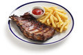 Barbecued pork spare ribs and french fries Royalty Free Stock Photo