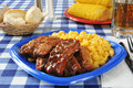 Barbecued ribs with macaroni and cheese on a picnic table Stock Photography