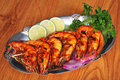 Barbecued shrimp on platter Stock Photography
