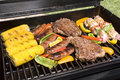 Barbecued steaks, brats, corn and chicken Royalty Free Stock Photography