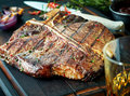 Barbecued t-bone steak seasoned with herbs Royalty Free Stock Photo