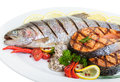 Barbecued trout close up grilled and salmon steaks with vegetables and oysters Stock Images