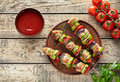 Barbecued turkey or chicken meat shish kebab skewers with ketchup Royalty Free Stock Photo
