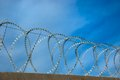 Barbed wire on a background of blue sky Stock Image