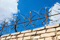 Barbed wire on blue sky background Royalty Free Stock Photo