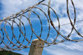 Barbed wire boundary protected site with Royalty Free Stock Images