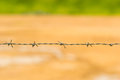 Barbed wire close up of fence with outdoor scene Stock Photos