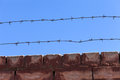 Barbed wire fence against blue sky Royalty Free Stock Image