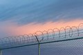 Barbed wire fence and sky Royalty Free Stock Image