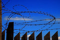 Barbed wire fence and sky Royalty Free Stock Photography