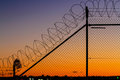 Barbed wire fence at sunset security Royalty Free Stock Photos