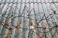 Barbed wire on roof, crime prevention Royalty Free Stock Photo