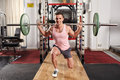 Barbell lunges in the gym Royalty Free Stock Photo