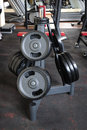 Barbell plates rack Royalty Free Stock Photography