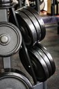 Barbell plates rack gym interior with holder Stock Photography