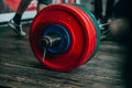 Barbell on a wooden floor Royalty Free Stock Photo