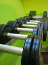 Barbells on rack Stock Photos