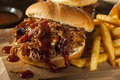 Barbeque pulled pork sandwich with bbq sauce and fries Royalty Free Stock Image