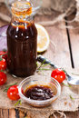 Barbeque sauce with tomatoes smoked salt and fresh herbs on rustic wooden background Stock Photos