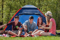 Barbeque youth on a camping young teenager group are having their holliday Stock Photography