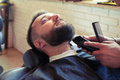 Barber with comb and electric razor Royalty Free Stock Photo