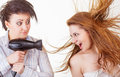 Barber hair dryer dries young cheerful women white background Stock Image