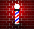 Barber pole on a wall Stock Image
