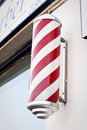 Barber s pole a traditional outside a shop Stock Images