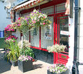 Barber shop front photo of a in whitstable town centre with pretty hanging baskets outside photo useful for high street shops Royalty Free Stock Images