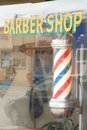 Barber shop sign and window front in downtown small city Royalty Free Stock Photography